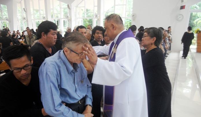 Fr. Corsie lays hands on those seeking a healing experience.