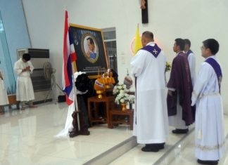 The priests are holding a minute of silence for King Rama IX.