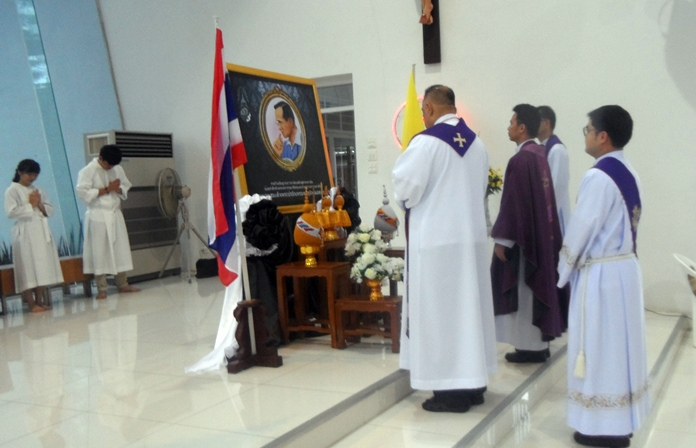 The resident and visiting priests hold a minute's silence for King Rama IX.