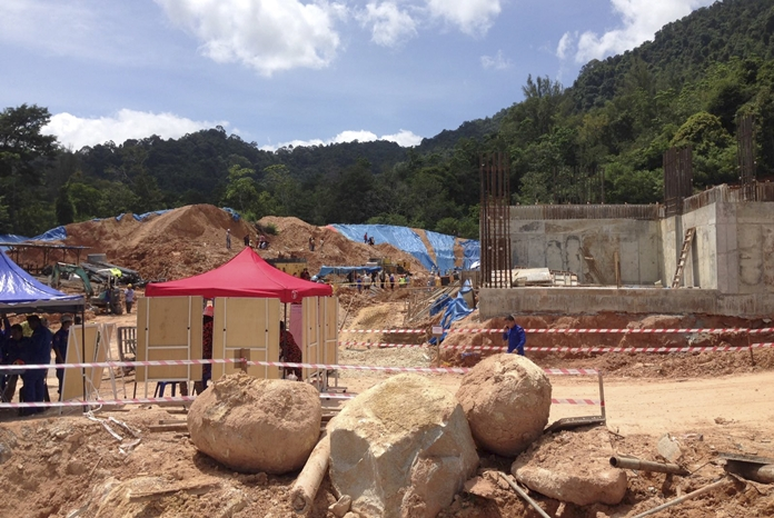 A rescue operation is conducted at a construction site after a landslide in Penang, Malaysia, Saturday, Oct. 21. (AP Photo/Peter Ewe)