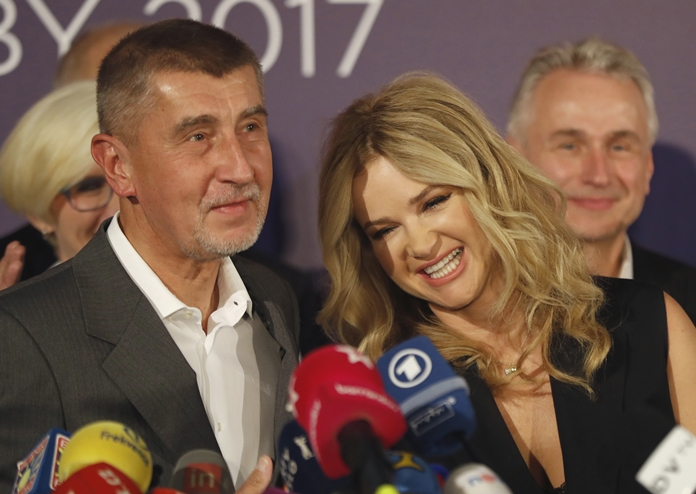 Czech billionaire and leader of ANO 2011 political movement Andrej Babis accompanied with his wife Monika addresses the media after most of the votes were counted in the parliamentary elections in Prague, Czech Republic, Saturday, Oct. 21. (AP Photo/Petr David Josek)