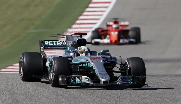 Mercedes driver Lewis Hamilton, of Britain, comes through a turn during the Formula One U.S. Grand Prix auto race at the Circuit of the Americas, Sunday, Oct. 22, in Austin, Texas. (AP Photo/Eric Gay)