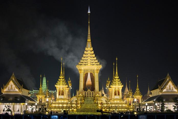 Smoke rises from the royal crematorium of His Majesty the late King Bhumibol Adulyadej in Bangkok, early Friday, Oct. 27, 2017. (AP Photo/Wason Wanichakorn)