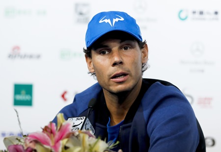 Rafael Nadal of Spain speaks during a news conference of the China Open tennis tournament at the Diamond Court in Beijing, Monday, Oct. 2. (AP Photo/Andy Wong)