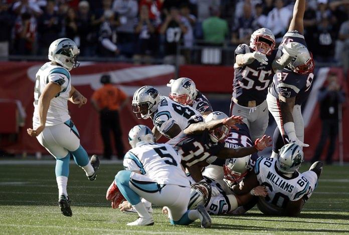 Carolina Panthers kicker Graham Gano, left, kicks the game-winning field goal against the New England Patriots, Sunday, Oct. 1, in Foxborough, Mass. The Panthers won 33-30. (AP Photo/Charles Krupa)