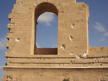 This photo taken in Sept. 2017 shows battle damage to Roman ruins in Sabratha, Libya. (Anti-ISIS Operation Room via AP)