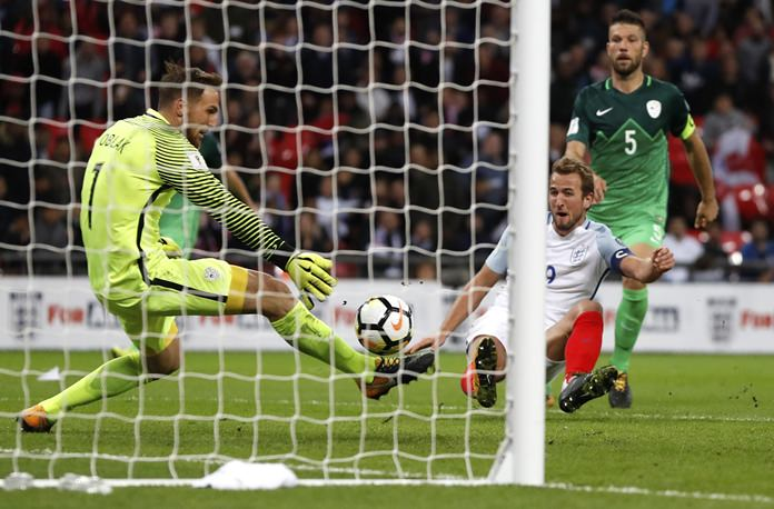 England's Harry Kane, center, scores the winning goal during the World Cup Group F qualifying match between England and Slovenia at Wembley stadium in London, Thursday, Oct. 5. (AP Photo/Kirsty Wigglesworth)