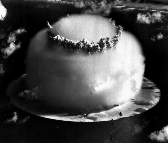 "In this July 25, 1946 file photo, a huge mushroom cloud rises above Bikini atoll in the Marshall Islands following an atomic test blast, part of the U.S. military's ""Operation Crossroads."" (AP Photo)"