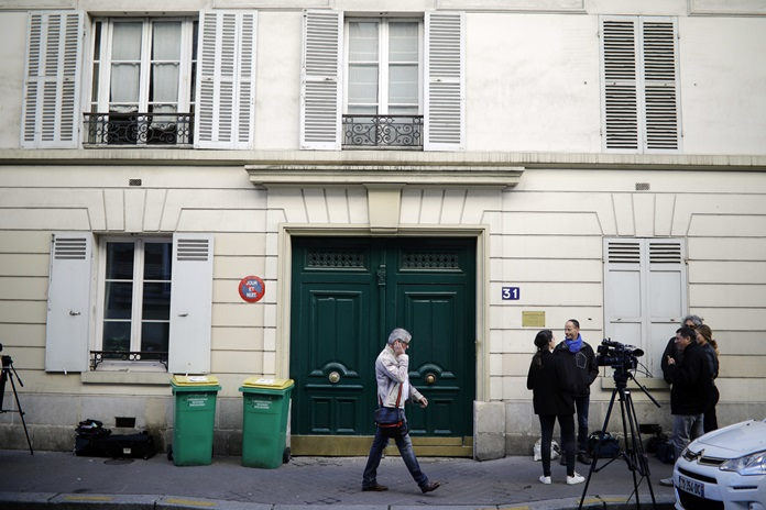 A Tuesday, Oct. 3, 2017 file photo shows the entrance of an apartment building where police found an explosive device last week. Three men have been handed preliminary terror-linked charges in the failed attack. (AP Photo/Kamil Zihnioglu)