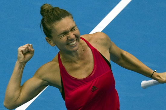 Simona Halep of Romania celebrates defeating Jelena Ostapenko of Lativa during their women's singles semi-final match at the China Open tennis tournament in Beijing, China, Saturday, Oct. 7. (AP Photo/Ng Han Guan)