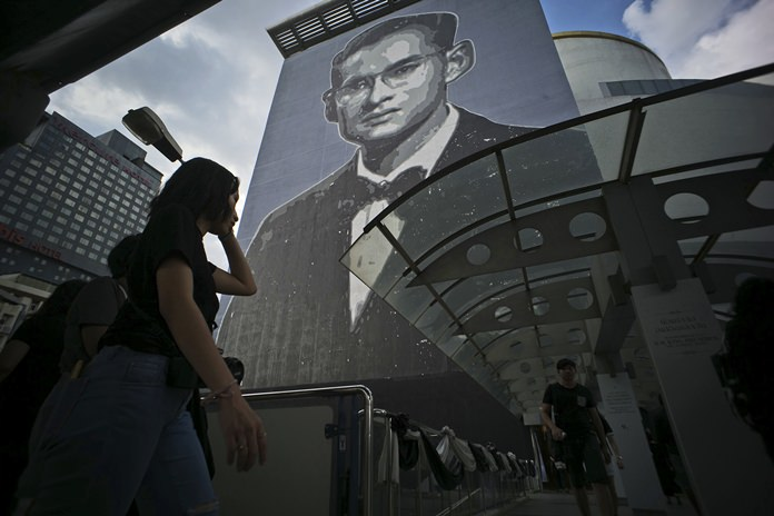 An image of the late Thai King Bhumibol Adulyadej covers the side of a building in Bangkok. (AP Photo/Charles Dharapak)