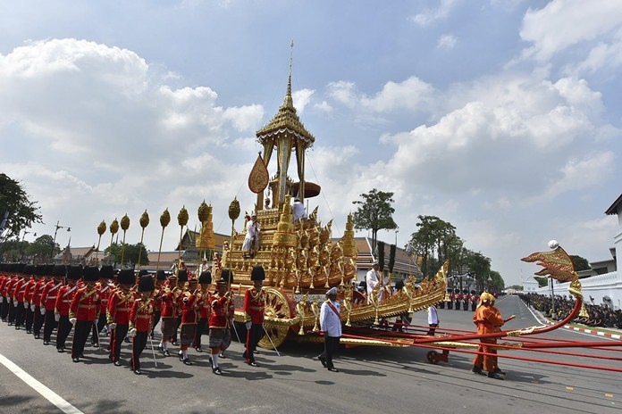 "The symbolic urn is transported during the funeral procession of late King Bhumibol Adulyadej in Bangkok, Thursday, Oct. 26, 2017. A ceremony in an ornate throne hall Thursday morning began the transfer of the remains of Thailand's King Bhumibol Adulyadej to his spectacular golden crematorium in the royal quarter of Bangkok after a year of mourning for the monarch Thais hailed as ""Father."" (AP Photo/Kittinun Rodsupan)"