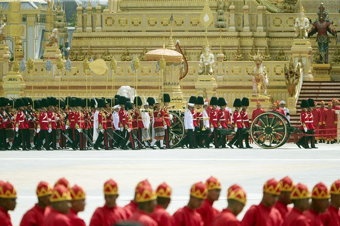 The ceremonial urn of HM the late King Bhumibol Adulyadej arrives at the crematorium during the funeral procession as royal crematorium is seen in the background. (AP Photo/Wason Wanichakorn)