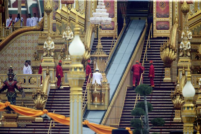 The ceremonial urn of the late King Bhumibol Adulyadej is raised into the royal crematorium and the end of the funeral procession on Thursday, Oct. 26. (AP Photo/Wason Wanichakorn)