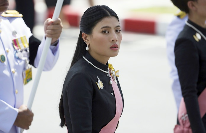 HRH Princess Sirivannavari Nariratana walks during a procession moving her grandfather, late King Bhumibol Adulyadej's ashes to special locations for further Buddhist rites in Bangkok Friday, Oct. 27, 2017. (AP Photo/Wason Wanichakorn)