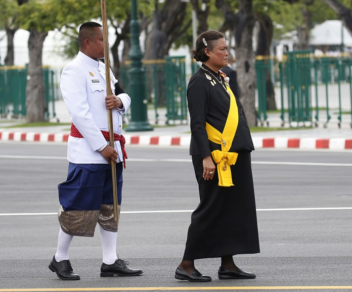 Princess Maha Chakri Sirindhorn walks in the funeral procession of her father, the late Thai King Bhumibol Adulyadej Bangkok. (AP Photo/Sakchai Lalit)