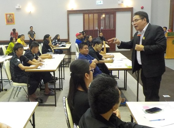Boontart Sopa, director of equality and litigation support at the Department for Empowerment of Persons with Disabilities, teaches Pattaya-area disabled residents how to ace a job interview and informs them of their legal rights during a Redemptorist Vocational School seminar.