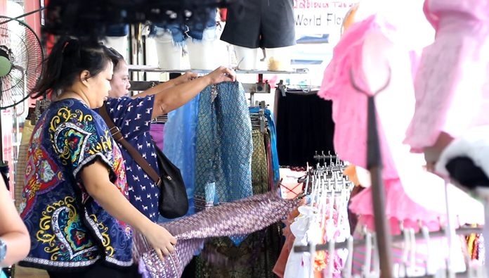 Thai clothing shops were bustling with shoppers looking for traditional Thai apparel in preparation for Loy Krathong.