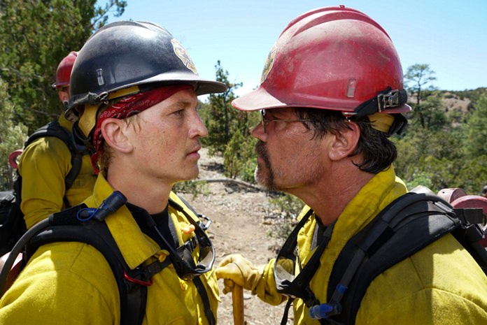 "This image shows Miles Teller (left) and Josh Brolin in a scene from ""Only the Brave."" (Richard Foreman Jr./Sony Pictures via AP)"