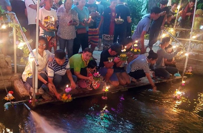 Participants float their krathongs at Wat Nongyai.