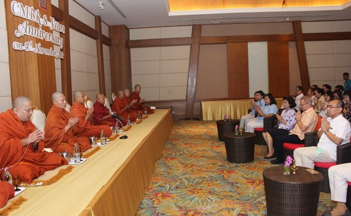 Nine monks from Jittapawan Temple chant before being treated to a lunchtime meal.