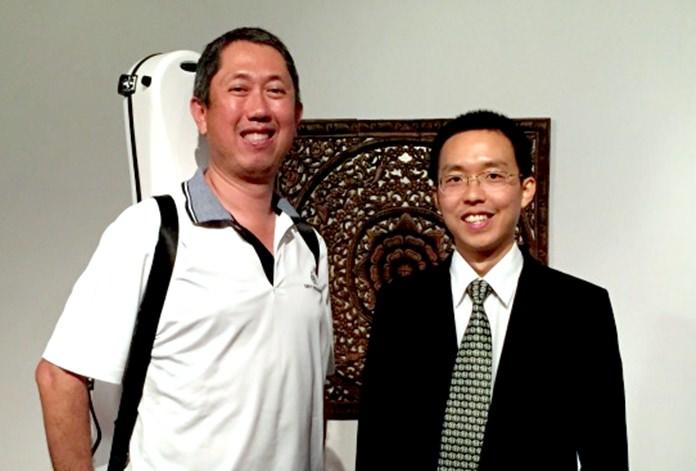 CGO founder Sira Tindukasiri (left) with conductor Apichai Chantanakajornfung.