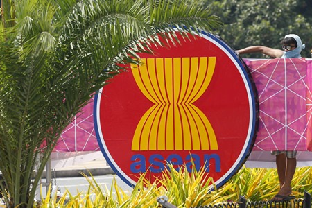A worker puts finishing touches on an ASEAN logo for the ASEAN leaders' summit and related summits Monday, Nov. 6, 2017 in suburban Pasay City, southeast of Manila, Philippines. ASEAN leaders and its dialogue partners such as the United States, Russia, China, Japan, South Korea, India, Australia, Canada, New Zealand, the European Council and U.N. Secretary-General Antonio Guterres attended the summit. (AP Photo/Bullit Marquez)