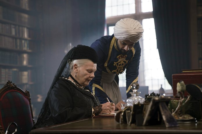 "Judi Dench (left) and Ali Fazal appear in a scene from ""Victoria and Abdul."" (Peter Mountain/Focus Features via AP)"