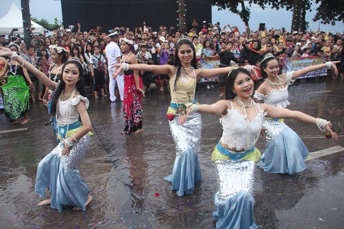 Representatives of tourism businesses in and around Pattaya parade in full color.
