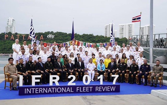 Prime Minister Prayut Chan-o-cha, Defense Minister Prawit Wongsuwon, and RTN commander-in-chief Adm. Naris Pratumsuwan gather top officers of the 26 warships from 19 countries for a commemorative group photo at Bali Hai Pier.