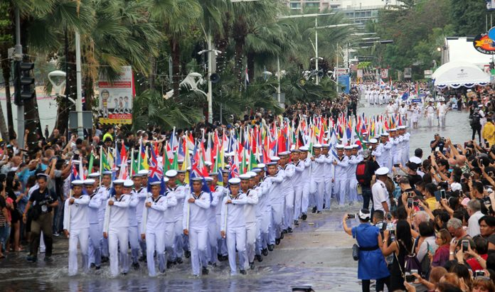 Thai sailors almost had to swim down Pattaya Beach Road through the floods as they carry flags from 40 different countries.