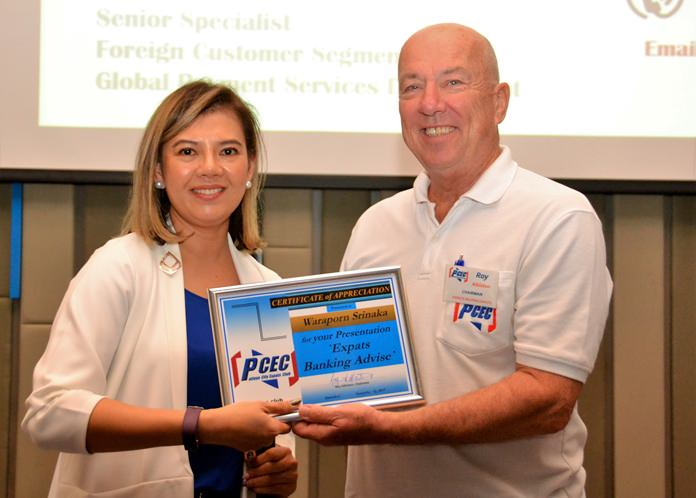 MC Roy Albiston presents the PCEC's Certificate of Appreciation to Waraporn for her informative talk and advice on Expat banking in Thailand.