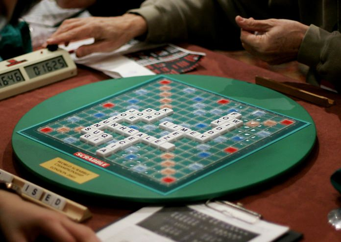 Competitors take part in the World Scrabble Championships in London. (AP Photo/Matt Dunham)