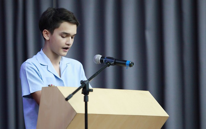 A Secondary student reads 'In Flanders Field'.