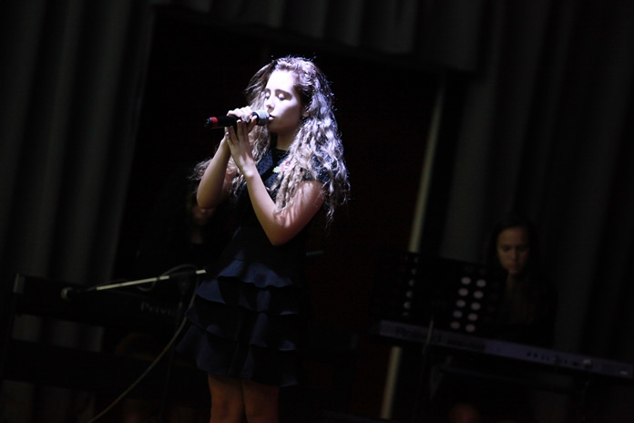 A Year 11 student sings at the whole-school assembly.