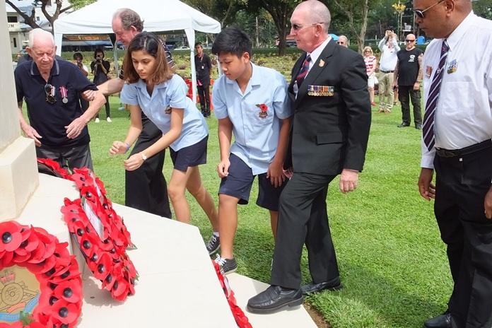GIS students lay a wreath on behalf of the school at the War Cemetery in Kanchanaburi.