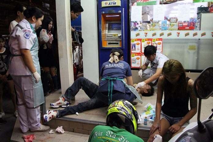 Paramedics work on Charoen Aksornarong who stepped into a catfight to defend his girlfriend and was stabbed for his troubles.