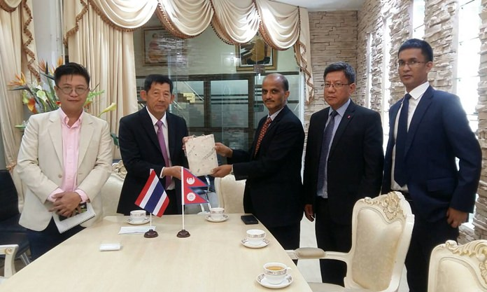 Mayor Anan Charoenchasri and officials greet H.E. Khaga Nath Adhikari, Nepal's ambassador to Thailand.