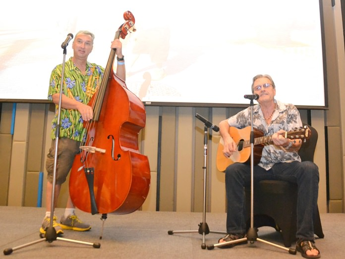 Pattaya musicians Bernie Webb on guitar with Paul Rosenberg on double bass entertained with several popular songs appropriate for their PCEC audience with many of them joining in.