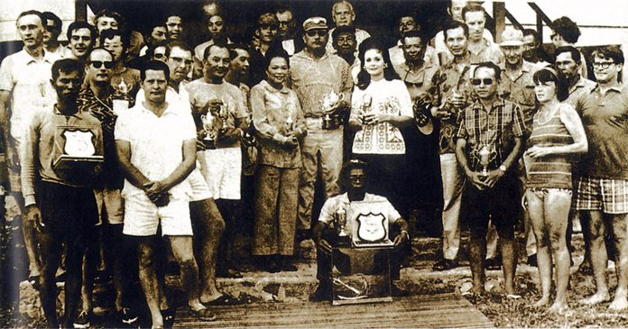 This photo from 1970 shows a group of prize winners with their trophies after a round the islands race at Varuna.