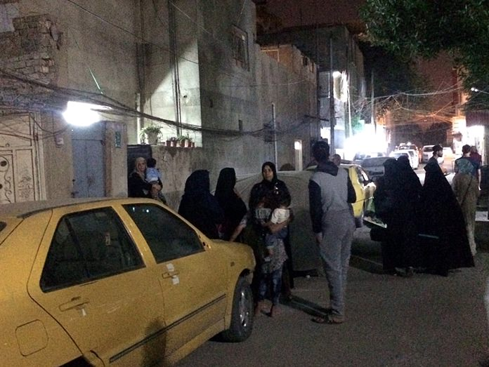 People stand in the street after feeling aftershocks from an earthquake in Baghdad, Iraq, Sunday, Nov. 12. The deadly earthquake hit the region along the border between Iran and Iraq on Sunday. (AP Photo/Hadi Mizban)