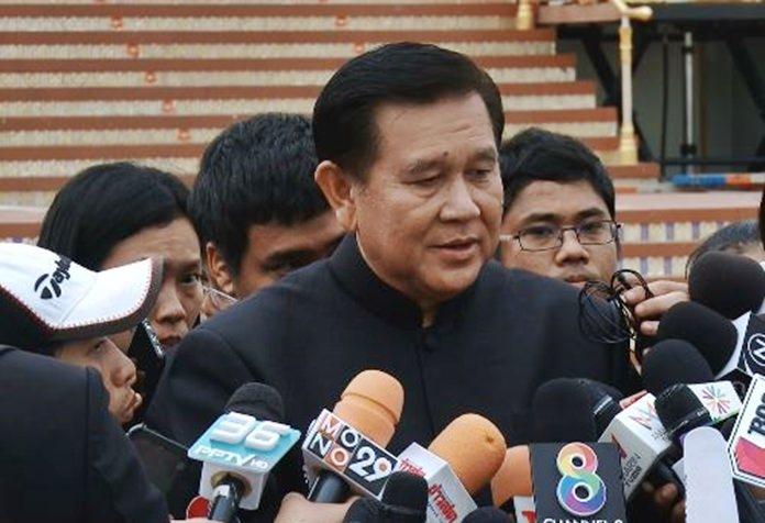 Deputy Prime Minister Gen Tanasak Patimapragorn talks to the media.