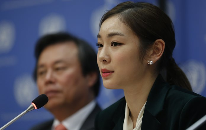 South Korea's 2010 Olympic gold medalist figure skater Yuna Kim, right, speaks during a press conference, Monday Nov. 13, 2017 at U.N. headquarters in New York. (AP Photo/Bebeto Matthews)