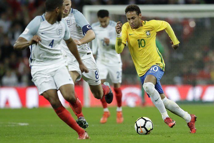 Brazil's Neymar takes the ball forward watched by England's Joe Gomez, left, and Eric Dier during the international friendly soccer match between England and Brazil at Wembley stadium in London, Tuesday, Nov. 14. (AP Photo/Matt Dunham)