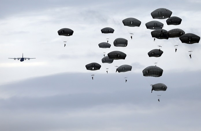 Members of the U.S. Army 173rd Airborne Brigade and Serbian Army parachutists jump from a US Air Force C-130 transport aircraft during a bilateral Serbian and U.S. airborne exercise at Lisicji jarak airport, some 15 kilometers north of Belgrade, Serbia, Friday, Nov. 17. (AP Photo/Darko Vojinovic)