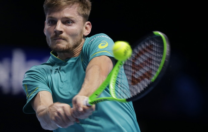 David Goffin of Belgium plays a return to Dominic Thiem of Austria during their mens singles tennis match at the ATP World Finals at the O2 Arena in London, Friday, Nov. 17. (AP Photo/Alastair Grant)