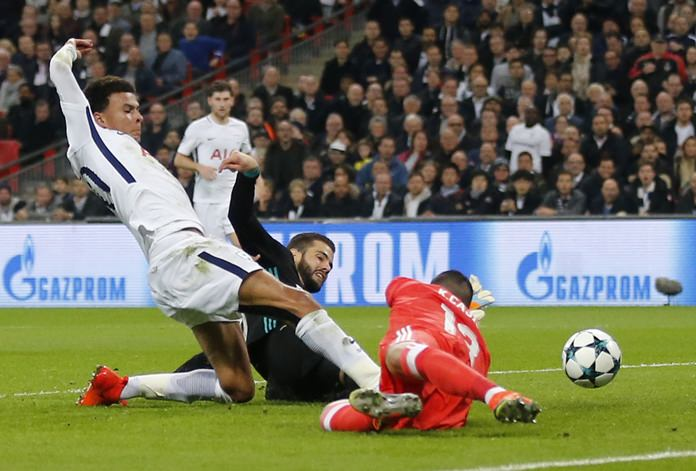 Tottenham's Dele Alli, left, scores the opening goal past Real Madrid's goalkeeper Kiko Casilla, right, during their Champions League group H match at Wembley Stadium in London, Wednesday, Nov. 1. (AP Photo/Frank Augstein)