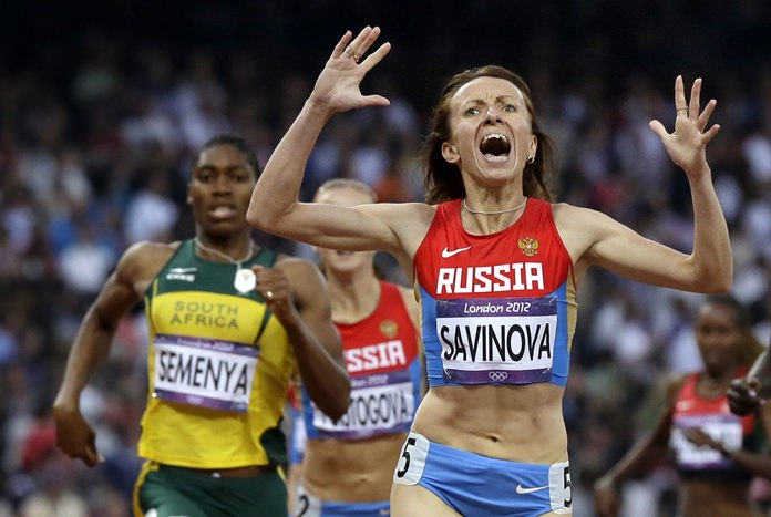 In this Saturday, Aug. 11, 2012 file photo, Russia's Maria Savinova celebrates as she crosses the finish line ahead of South Africa's Caster Semenya to win the women's 800-meters final at the 2012 Summer Olympics, London. (AP Photo/Anja Niedringhaus)
