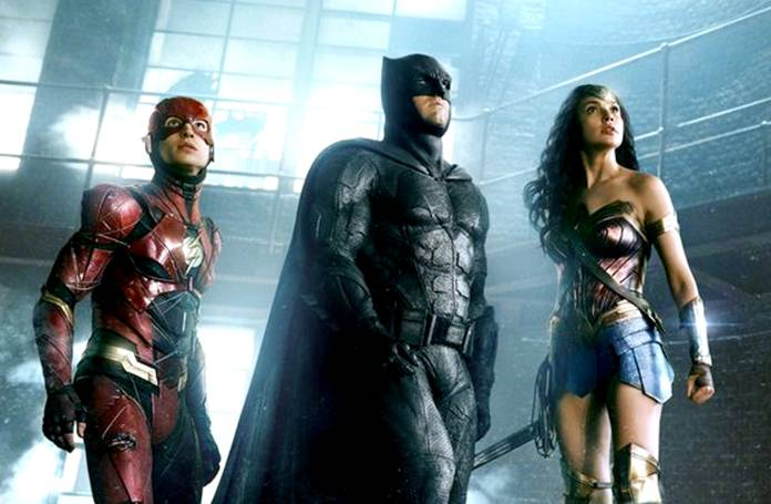 "This image shows Ezra Miller (from left) Ben Affleck and Gal Gadot in a scene from ""Justice League."" (Warner Bros. Entertainment Inc. via AP)"