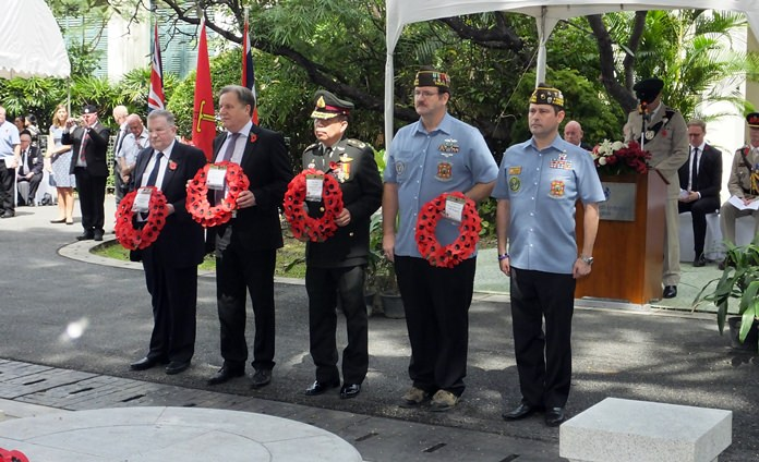 Members of the British Club Bangkok (left) and War Veterans Association (right).